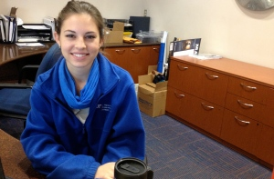 (by Laici Little) Virginia Martinez sits behind her desk at the information booth in the J. Wayne Reitz Union.