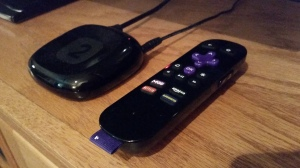 The Roku 2 (with included remote) is compact and portable. The remote includes shortcut buttons to popular apps like Netflix and Amazon Instant Video. Photo by: Bryan Faux