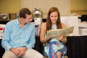 Sean and Christina take it all in at the bridal shower. Photo by Christina Hunt.