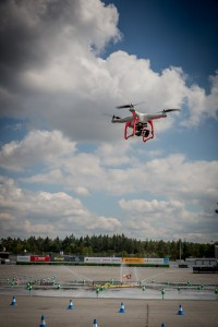 At a Formula 1 event in Germany, a drone is used to capture an aerial view of the track before a vehicle showcase takes place. Photo credit to SmugMug.